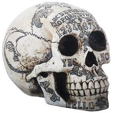"A very unique skull with all the Ouija symbols carved in. Great for Halloween or for the person who likes to collect gothic things! Makes a great gift! Made of cold cast resin. Hand painted. L: 8.5"" x"