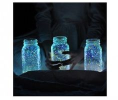 Glow in the dark paint splattered on mason jars, I want to try it with laundry detergent and neon paint under a black light, too.
