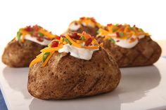 Make baked potatoes on the grill with our Grilled 'Baked' Potatoes recipe. With a fluffy inside and crispy outside, these grilled potatoes sure are tasty.