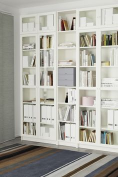 Adjustable wall shelving ikea to a wall to wall library the billy bookcase system has it covered it comes in different heights widths and finishes with Glass Corner Shelves, Wall Shelves, Ikea Billy Bookcase Hack, Billy Bookcases, Billy Bookcase With Doors, Bookcase Styling, Bookshelf Design, Office Storage, Adjustable Shelving