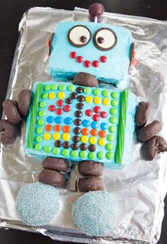 It's finally here – a recap of my little babe's 1st birthday party.  Let's start with the robot-decorated cake. I totally found a picture like this cake on Pinterest and put my own spin on it. Basically I baked a 9 x 13 cake and cut it up to create the body and the...