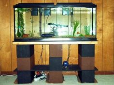 Build an aquarium stand. Cheaper, stronger, customizable. Great for large tanks.