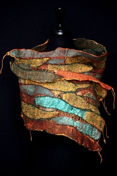 Hand dyed silk and recycled sari silk scarf hand felted with fine merino wool.