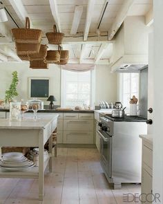 rustic white ceiling...baskets