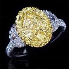 GIA CERTIFICATED 18K GOLD FANCY LIGHT YELLOW DIAMOND