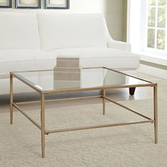 With its tempered glass surface and understated golden frame, this chic coffee table lets your favorite art books and statuettes take center stage.