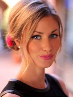 subtle girly-fushia lipstick and a flower in your bun with a black top