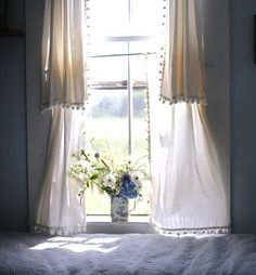 wild flowers and light curtains with a pom pom fringe