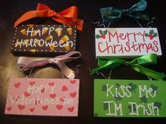 Set of four holiday signs by whatsyoursigndesigns on Etsy, $25.00