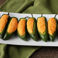 Stuffed Jalapenos.. I know a group of guys that would love these! Jalapeno's, Cream Cheese, Cheddar Cheese, & salt, bake at 400 20-25 minutes