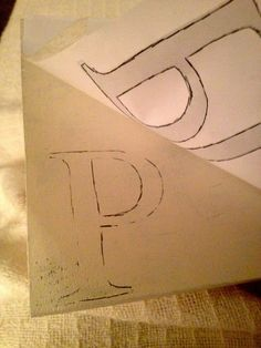 Transferring letters to wood with pencil and paper