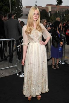 Elle stunned at the Super 8 premiere in this embroidered, flowy white number.