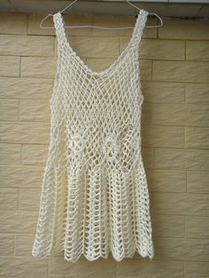 Boho Short Crochet Beach Dress Bikini Cover Up Perfect as a beach cover up and makes a beautiful summer dress for festivals, parties, or lazy days.  Measurement: Bust: M (34-37) Length: 27 Crocheted in easy care acrylic yarn, hand wash, or roll in a towel to remove excess water and