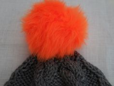 Gray hand knitted cabled hat with fur orange pom pom by KnitSew4U