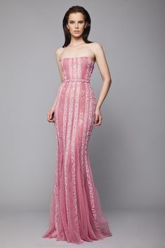 Pink strapless floor length dress in Lace and embroidered Tulle, with vertical crystal beading and belt on the waistline.