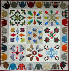 """""""A Few of my Favorite Things"""" quilt by Jane Zillmer, quilted by Ann Becker, Always in Stitches.   Hand appliqued in wool on cotton.   Block designs by Jane Zillmer and Tina Curran."""