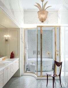 Splendor in the Bath. White and gold and glass. Interior Designer: Jamie Drake.