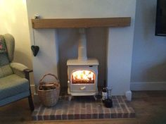 A recent fireplace installation in Welling, stunning wood burning stove. Oak Beam Fireplace, Log Burner Fireplace, Small Fireplace, Home Fireplace, Wood Burner, Fireplace Ideas, Feature Wall Living Room, Living Room Setup, Cottage Living Rooms