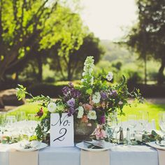 Our rentals showcased on a beautiful vineyard wedding table scape. GYC provided the glassware, silverware, and china.