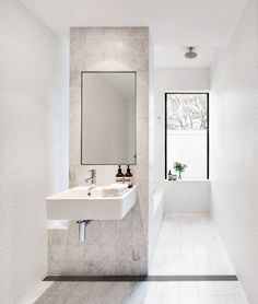 "Fun and functionality collide in a children's bathroom. ""The aim was to provide views to a much-loved gum tree and to create a robust children's bathroom, that would be a fun and creative experience for the two toddlers who would be using it,"" says Jeremy Bull, the bathroom's designer.   Matt white penny round **mosaic tiles** and Carrara **marble tiles** from [Bisanna Tiles](http://bisanna.com.au/