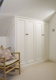 #ATTIC  Wardrobe makes good use of the space under the eaves.