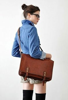 Love the bag! (and the glasses, the denim shirt, the shorts and thigh-high socks and the bun!)