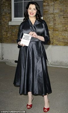 Stand in: Nigella at her husband Charles Saatchi's book launch at the Saatchi Gallery 2009