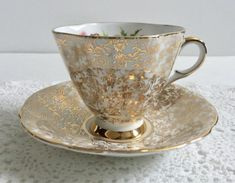 Pretty vintage china tea cup, made by Windsor China in England. Gold chintz on the outside of the teacup and saucer, white inside with thistles. It is in good condition, no chips, cracks or crazing. Please Note: The items I sell are not new, they are vintage or antiques, it