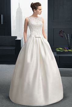 Brides: Two by Rosa Clará. Mikado and beaded guipure dress and train in a natural color.