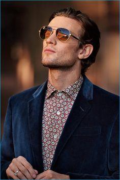 Actor Matt Smith rocks a Gucci velvet blazer with an Incotex print shirt, and Ray-Ban aviator sunglasses.