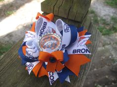 Denver Broncos INSPIRED Boutique Bow by AlyssasBowtique on Etsy, $9.99.  I bought one for me and my daughter!  We love them!