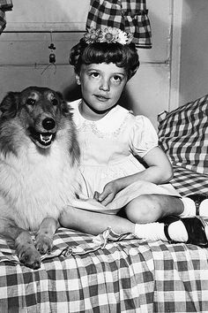 Sharon Tate, age 6, posing with 'Lady', 1949.