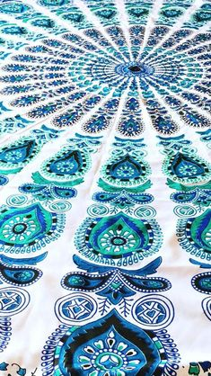I actually bought a huge bed sheet and drew a HUGE mandala on it hope you like it. Ps it took me 2 weeks.