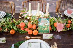 tropical tablescape - photo by PhotoNotions Photography http://ruffledblog.com/florida-wedding-with-a-citrus-wheel-backdrop