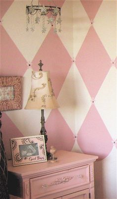 White and pink harlequin painted walls.  Beautiful!