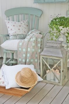 With this color scheme, handmade, blanket and weathered furniture, who wouldn't feel comfy here?