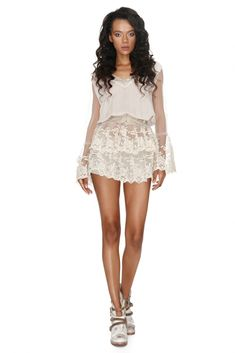 Broderie anglaise blooms on this Vero Milano embroidered ruffled top to add sweet to style on any Summer outfit. Featuring a flattering V-neck cut, full trumpet sleeves and playful translucent ruffles, for a diaphanous appearance. Best Sellers, Dresses Online, Lace Shorts, Designer Dresses, Ruffles, Summer Outfits, Sweet, Sleeves, Coachella