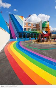 A Kindergarten Building Covered In Rainbows