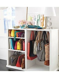 Old dresser repurposed as bag storage and display