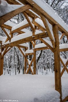 This is a timber frame from a number of years ago. We were able to raise the frame just before winter took its hold. http://www.facebook.com/MadeByVMWorks