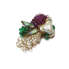 GEM-SET  AND DIAMOND BROOCH, CARTIER, 1980S Designed as a fish, set with a blister and abalone pearls, ruby and emerald beads, brilliant-cut and rose diamonds, signed Cartier, Paris and numbered, French assay and maker's marks.