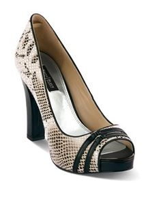 "Python markings, a neutral palette and a chunky black heel give this soft pump unlimited options. Silvertone footbed. 4"" heel; .5"" platform. Fabric upper; leather sole. Imported."