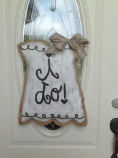 A personal favorite from my Etsy shop https://www.etsy.com/listing/245205128/wedding-dress-burlap-door-hanger-wedding