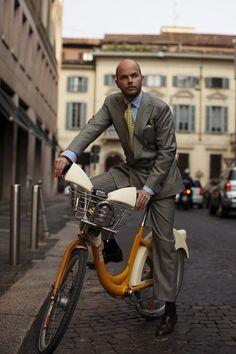 Italian men on bicycles. Wow.... fashion
