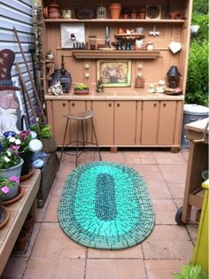 wow...a rug made out of garden hoses & black zip ties