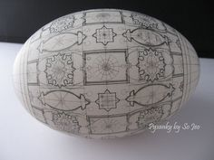 I do these!  This one is very intricate-looking, but I do something similar...Ukranian Easter Eggs.
