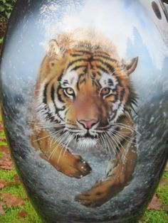 An Airbrushed Tiger Leaps Through Water On A Harley Davidson Vrod Tank.