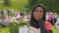 "When Nadiya pointed at her trophy and herself when she won the Great British Bake Off. | The 30 Best BBC Moments Of ""The Great British Bake Off"""