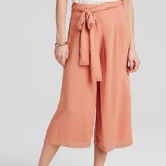 Free People Black High Rise Culottes Brand new, just taken out of plastic to try on and they don't fit me. Solid black. Stretch back and tie in front. Size Medium. Paid full price. Free People Pants Ankle & Cropped