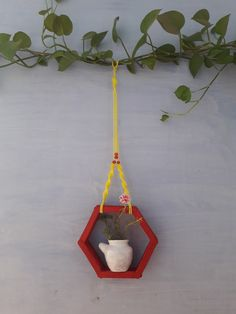 Super simple yet beautiful The pink holder made of painted icecream sticks and hanger of yellow macrame Rajasthani Art, Super Simple, Icecream, Terrarium, Sticks, Macrame, Hanger, Planter Pots, Yellow